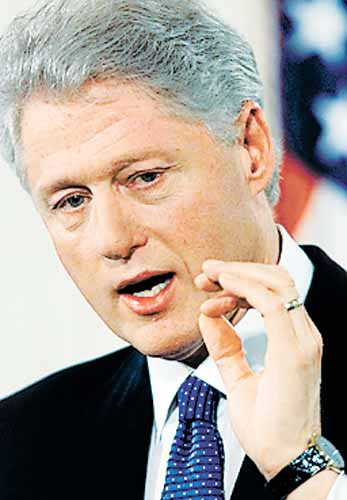 Bill Clinton, either measuring Jackson's package, playing the world's smallest violin or illustrating how much truth he told America